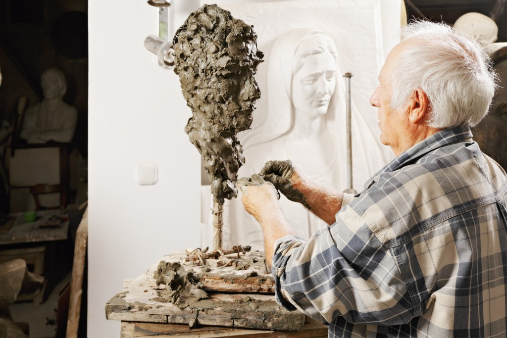 artist doing a sculpture