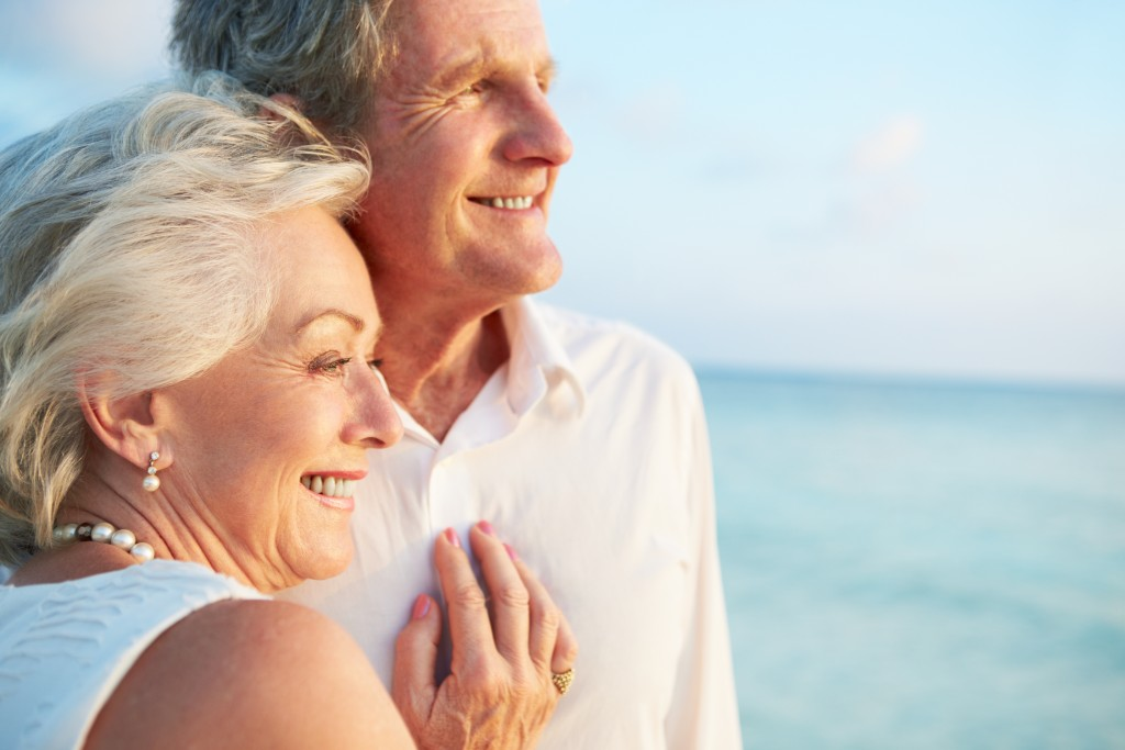 elderly couple looking over the horizon
