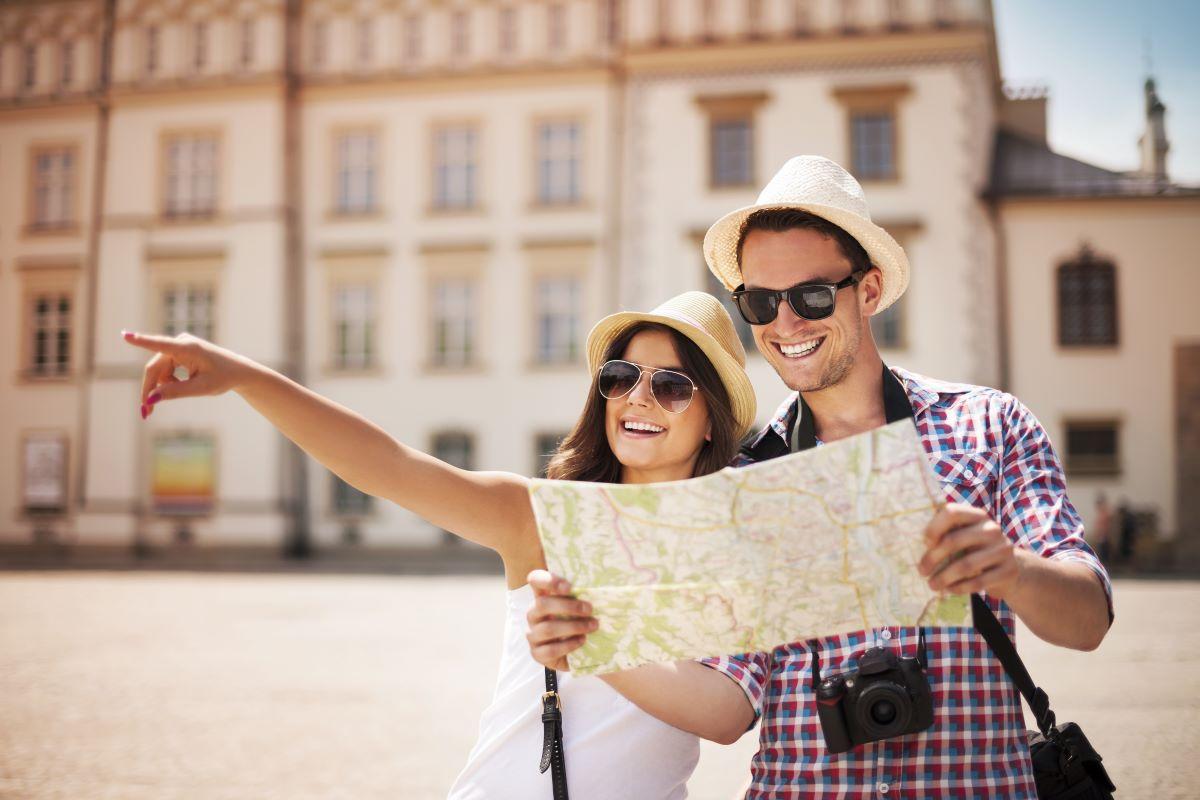 tourist couple holding map