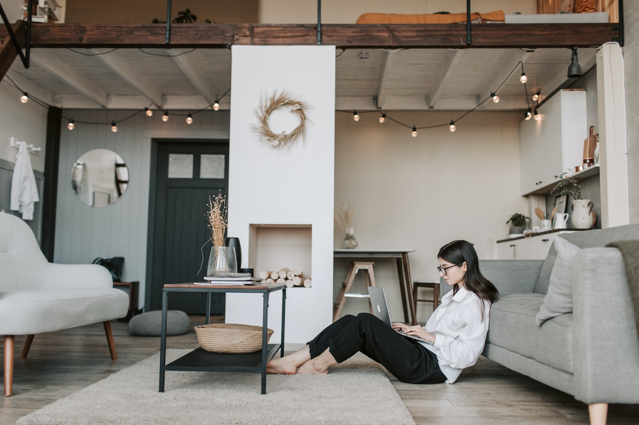 woman sitting on the floor working remotely