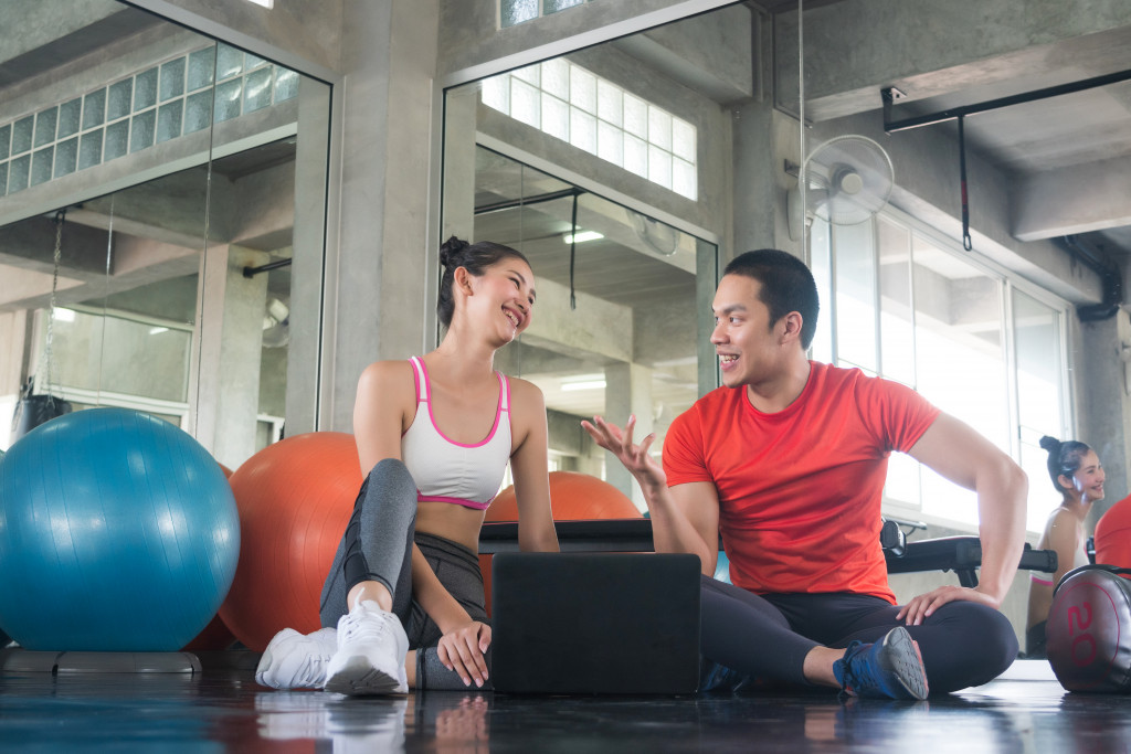 two people planning a fitness business