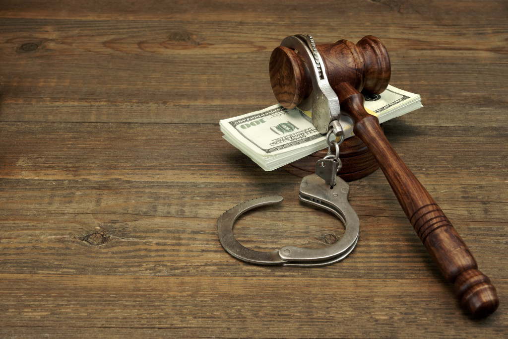 gavel, handcuffs, and cash