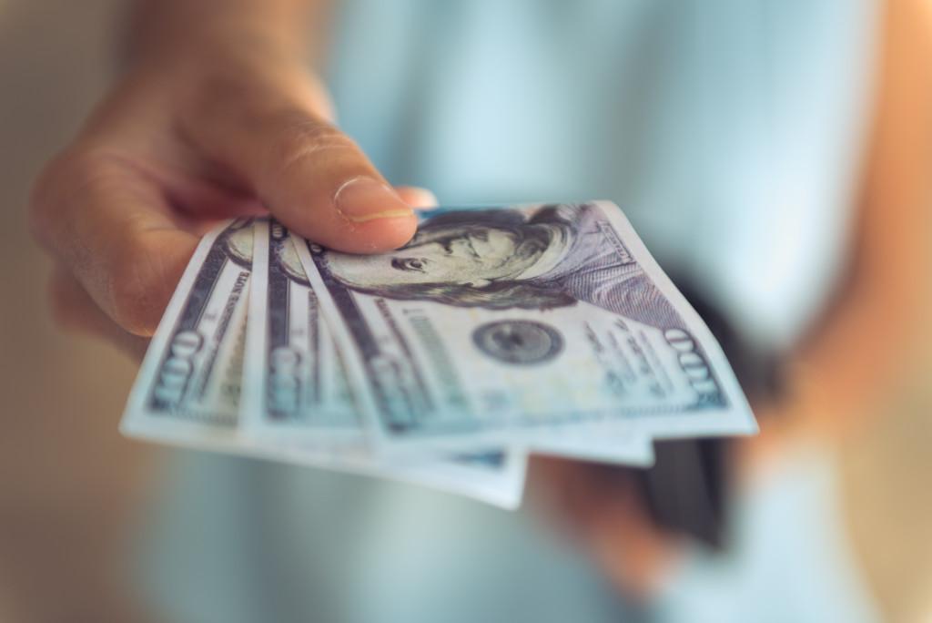 man paying in cash