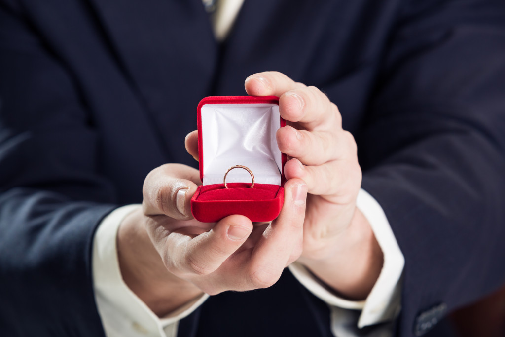 man presenting an engagement ring